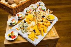 Cheese on a plate on a table. With salads stock photos