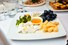 Cheese plate on a table. In a restaurant Royalty Free Stock Image