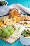 Cheese plate on a table Stock Photos