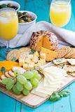 Cheese plate on a table Royalty Free Stock Image