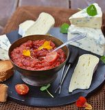 Cheese plate with tomato chutney Stock Photography