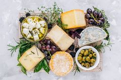 Cheese plate, top view. Cheese plate made from different kinds of cheese, fruit and greens, top view royalty free stock photo