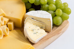 Cheese plate variation isolated white Stock Images