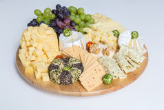 Cheese plate variation on white background Royalty Free Stock Image