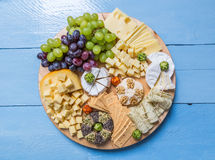 Cheese plate variation on a wooden blue table Royalty Free Stock Images