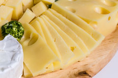 Cheese plate variation on a wooden table Royalty Free Stock Image