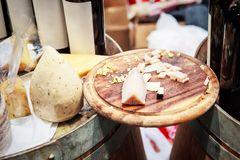 Cheese plate - various types of cheese. On a wooden cutting board royalty free stock photography