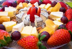 Cheese plate - various types of cheeses and strawberry. French cheeses. Spain stock photography