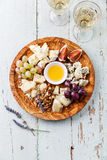 Cheese plate and wine Royalty Free Stock Photos