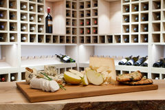 Cheese plate and wine rack. Cheese plate in wine rack stock image