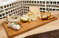 Cheese plate and wine rack. Cheese plate in wine rack royalty free stock image
