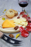 Cheese Plate, wineglass and autumn leaves Royalty Free Stock Photo