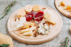 Cheese plate. With a wooden photon, cheese, large details Stock Photography