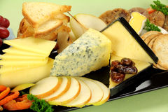 Cheese Platter. Delicious cheese platter with various cheeses and fruits ready to serve Royalty Free Stock Photography