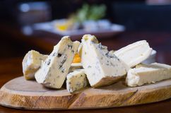 Cheese Platter. A cheese platter featuring blue vein and camembert cheeses Stock Image