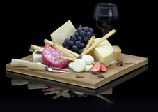 Cheese platter. With fruits and nuts Stock Photography