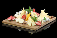Cheese platter. Various types of cheese on a cheese platter Royalty Free Stock Photography
