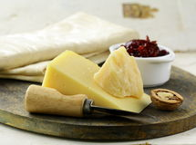 Cheese platter. With nuts and jam Royalty Free Stock Photo
