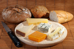Cheese platter. With some organic fresh cheese and bread Royalty Free Stock Photo