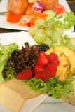 Cheese platter. Delicious cheese and fruit platter Stock Photography