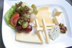 Cheese platter. Variaty of cheese on plate Royalty Free Stock Photo