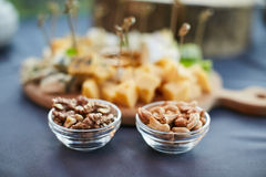 Cheese platter, Assorted with nuts and honey Royalty Free Stock Images