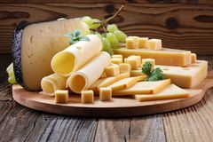 Cheese platter with different cheese and grapes. Cheese platter with different cheese and grapes royalty free stock photography