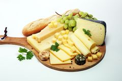 Cheese platter with different cheese and grapes. Cheese platter with different cheese and grapes royalty free stock photo