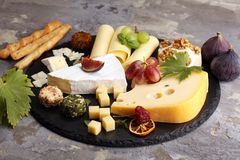 Cheese platter with different cheese and grapes. Cheese platter with different cheese and grapes royalty free stock image