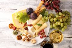 Cheese platter with different cheese and grapes. Cheese platter with different cheese and grapes royalty free stock images