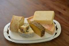 Cheese platter with different cheese Stock Photos