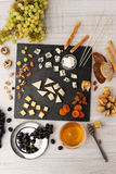 Cheese platter with different fruits and nuts  top view Stock Images