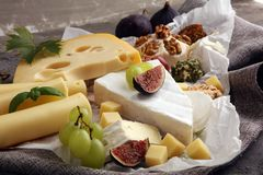 Cheese platter with different cheese and grapes. Cheese platter with different cheese and grapes stock images