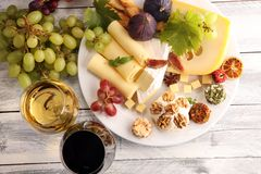 Cheese platter with different cheese and grapes. Cheese platter with different cheese and grapes stock photography