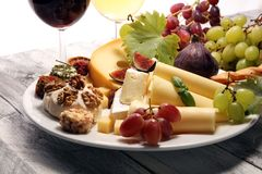 Cheese platter with different cheese and grapes. Cheese platter with different cheese and grapes stock photo