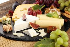 Cheese platter with different cheese and grapes. Cheese platter with different cheese and grapes royalty free stock photos