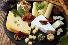 Cheese platter with different cheese and grapes. Cheese platter with different cheese and grapes stock image