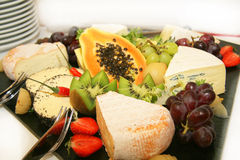 Cheese platter with different types of cheese. Grapes, kiwi and strawberries Stock Photography