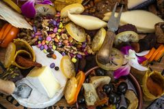 Cheese platter with different cheese types served with olives, fruits and nuts Royalty Free Stock Photography