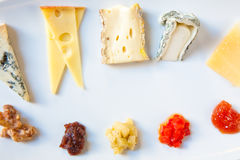 Cheese Platter. With five different cheeses and jellies Stock Photography
