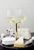 Cheese platter and glasses of wine Stock Photography