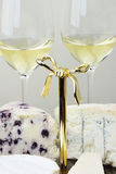 Cheese platter and glasses of wine Stock Images