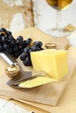 Cheese platter with grapes Royalty Free Stock Photos