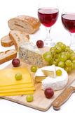 Cheese platter, grapes, bread, two glasses of red wine Royalty Free Stock Photo