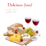 Cheese platter, grapes, ciabatta and two glass of red wine Royalty Free Stock Image