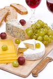 Cheese platter, grapes, ciabatta and two glass of wine Royalty Free Stock Image