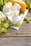 Cheese platter with grapes Royalty Free Stock Image