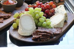 Cheese platter with grapes in a restaurant Royalty Free Stock Photos