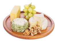 Cheese platter. With grapes and  walnutisolated on white Royalty Free Stock Image