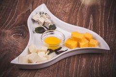 Cheese platter with jam Royalty Free Stock Photos